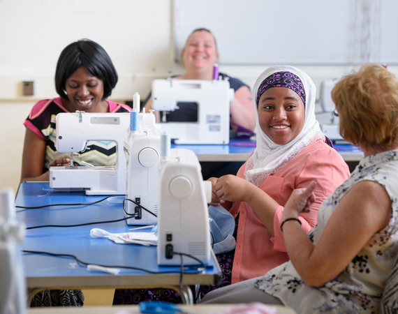 community group enjoying a sewing class